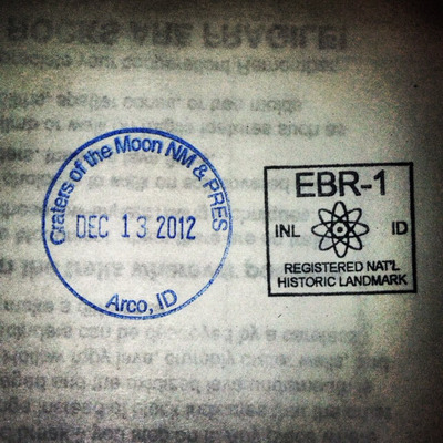 """Craters of the Moon National Monument Nat'l Parks stamp and EBR-1 """"Local"""" (but still awesome!) stamp."""
